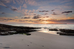 Sunrise skies at Chinamans Beach Jervis Bay. One of the beautiful idyllic beaches in Jervis Bay, Chinamans Beach at sunrise Stock Photo