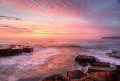 Sunrise skies and white water seas Royalty Free Stock Photo