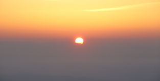 Sunrise sky above cloud Stock Photo