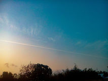 Sunrise sky with aircraft& x27;s smoke. Stock Images