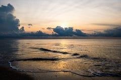 Sunrise sky background. Sunrise sky and beach wave background royalty free stock photos