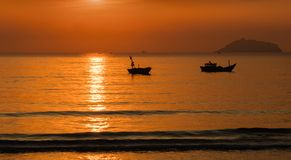 Sunrise Sky With Fishing Boats Stock Photos