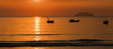 Sunrise Sky With Fishing Boats Royalty Free Stock Images