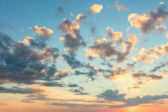 Sunrise sky with gentle colors of soft clouds and sun rays Royalty Free Stock Photo
