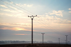 sunrise sky over power lines at Tatras Royalty Free Stock Photos