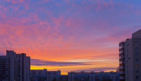 Sunrise sky over roofs Stock Photography