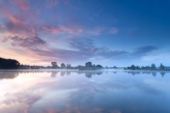 Sunrise sky reflected in river Royalty Free Stock Image