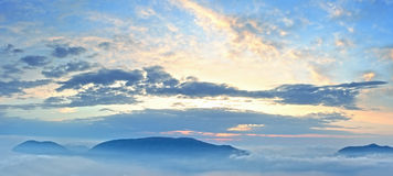 Sunrise sky view and mountain tops Royalty Free Stock Image