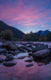 Sunrise on the Skykomish River, Washington State. A pink sunrise reflects off a small pool on the Skykomish River near the town of Index, Washington State Royalty Free Stock Photos