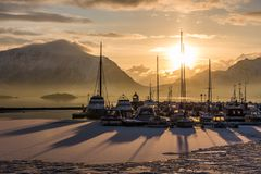 Sunrise in a port with boats in Lofoten, Norway. Sunrise in a small port with boats in Lofoten, Norway stock image