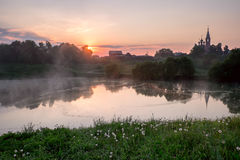 Sunrise in a small russian village. Royalty Free Stock Photo