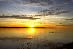 Sunrise and small ship Royalty Free Stock Images