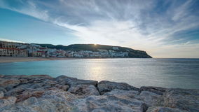 Sunrise at Small town of Sesimbra (Portugal. Sunrise from pier at Small town of Sesimbra (Portugal), panorama timelapse 4K stock video