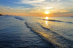 Sunrise and small wave Royalty Free Stock Image