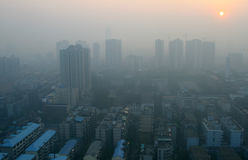 Sunrise through the smog in a modern Chinese city. Vv Royalty Free Stock Images