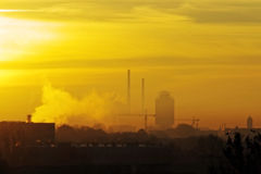 Sunrise and smokestacks Stock Image