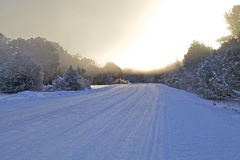Sunrise on Snow Covered Road Royalty Free Stock Photos