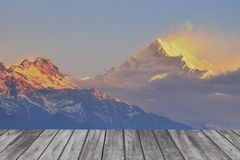 Sunrise snow mountain and Wood terrace landscape. Stock Image
