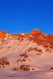 Sunrise in snow mountains Royalty Free Stock Image