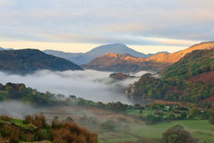 Sunrise in Snowdonia. Low cloud rising from Llyn Gwynant early one morning Stock Image