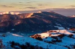 Sunrise in snowy Carpathian mountains Stock Photo