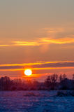 Sunrise at snowy frosty field Royalty Free Stock Photo