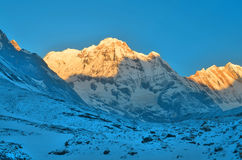 Sunrise in Snowy Mountain Landscape in Himalaya. Sun light. Annapurna South peak, Annapurna Base Camp Track. Royalty Free Stock Photos