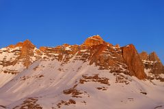 Sunrise at snowy mountains Stock Photo