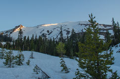 Sunrise at snowy Mt. St. Helens. Morning sun hitting the tops of Mt. St. Helens Stock Images