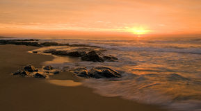 Sunrise on soft water seascape Stock Image