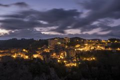 Sorano Sunrise. Sunrise at Sorano Grosseto town built od rocks in Tuscany, Italy stock images