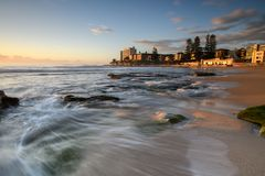 Sunrise at South Cronulla Beach in Sydney. With flowing waves breaking on he sandy beach stock photos