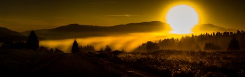 The sun fills the valley royalty free stock photo