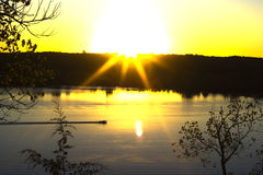 Sunrise st croix. Boat passing on the st. croix river in mn Stock Image