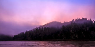 Sunrise starting to  burn off the fog. At Big River, Mendocino, California Stock Photo
