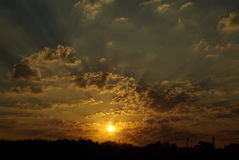 Sunrise. In the steppe. rays and clouds Stock Photography