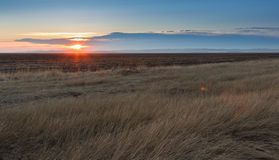 Sunrise in the steppes Stock Images
