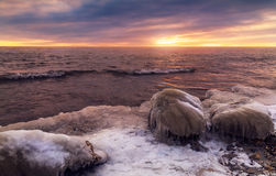 Sunrise with stone on ice. Winter landscape Stock Image