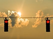 Sunrise Stop Lights. A pair of stop lights at sunrise in the city Royalty Free Stock Photo