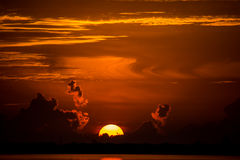 Sun rising over the clouds on a stormy morning. Golden sunrise as the sun rises above the clouds Royalty Free Stock Images