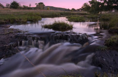Sunrise stream of water Stock Image
