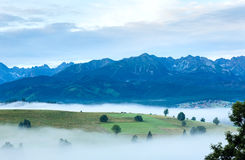 Sunrise and summer misty mountain country view Royalty Free Stock Photo