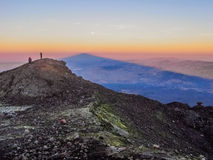 Sunrise from the summit of mount Etna. The shadow of mount Etna during the sunrise as seen from the summit craters Stock Photography