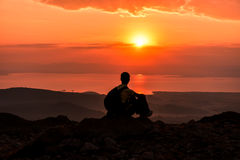 Sunrise at the summit of the mountain. A sunrise is a symbol of a new day, a new chance, a new beginning and maybe new opportunities. Pure sunlight is white in Stock Photos