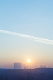 Sunrise sun in blue sky over city in cold winter Royalty Free Stock Photography
