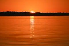 Sunrise. Sun reflection in water sea bay. Mitchell River Silt stock image