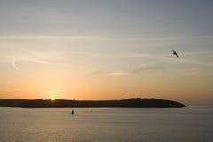 Sunrise. The sun rises at daybreak over St Anthony`s Head, Cornwall, UK stock photo