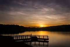 Sunrise. The sun is rising on the lake Stock Images