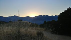 Sunrise. The sun slowly rises over the San Gabriel Mountains Royalty Free Stock Photo