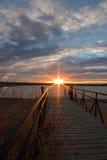 Sunrise sunburst over a fishing dock Stock Photography